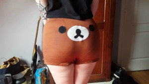 Hot tattooed girl dances in cute kawaii bear hotpants.