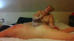 ssbbw wife works over husband with flogger, crop, slapper, and hand